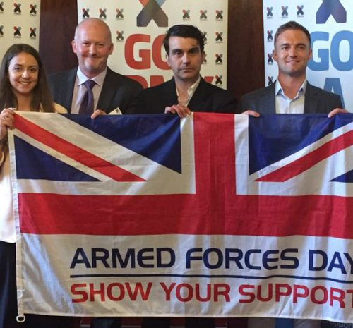 Supporters holding up Armed Forces Day flag
